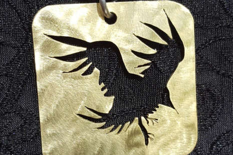 Pierced Bronze Crow in Flight Pendant