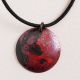 A handcrafted minimalist copper domed disk pendant necklace with a lovely red fi